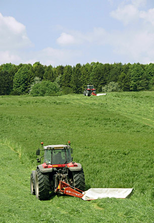Haylage mowing for Highclere Castle Horse Feeds on the Highclere Estate.