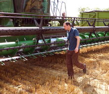 Simon Andrews with the combine harvester.